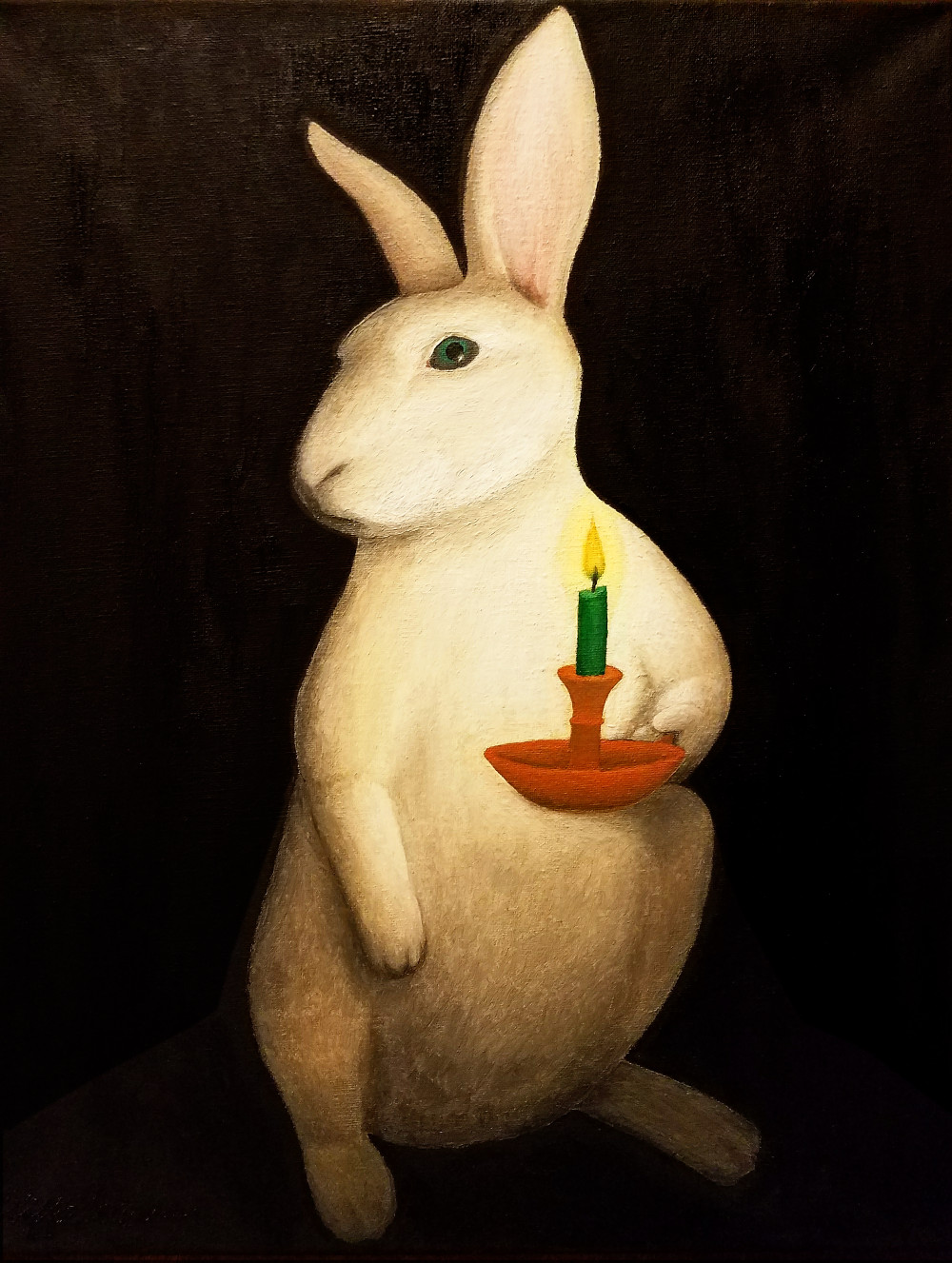 white rabbit holding a candle